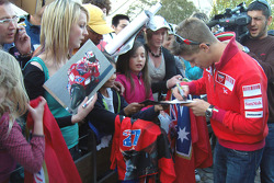Casey Stoner signs autographs