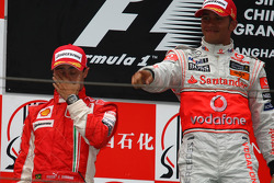 Podium: race winner Lewis Hamilton, second place Felipe Massa