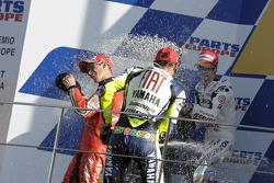 Podium: Casey Stoner, Dani Pedrosa and Valentino Rossi spray champagne
