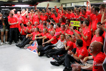 2008 World Champion Lewis Hamilton celebrates with Ron Dennis, Heikki Kovalainen and Mercedes team members