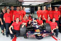 Sebastian Vettel and crew members