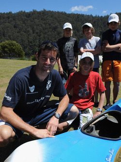 Launceston, Australia: Mark Webber poses with children from Devonport High School