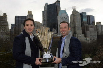 Jimmie Johnson and Chad Knaus pose with the NASCAR Sprint Cup Series trophy in Central Park in front of the New York City skyline