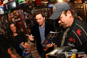 NASCAR Sprint Cup Series champion Jimmie Johnson signs autographs for Official NASCAR Members Club fans at Foley's