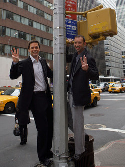Jimmie Johnson, winner of the 2008 NASCAR Sprint Cup Championship, poses with crew chief Chad Knaus at the 48th and 3rd intersection