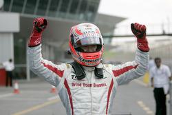Race winner Kamui Kobayashi celebrates