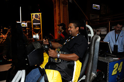 A fan takes a spin in a simulator at Tailgate City Driven By Ford in midtown Manhattan