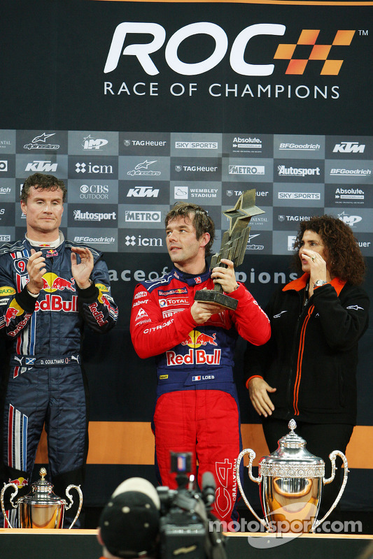 Podium: Race of Champions winner Sébastien Loeb receives his trophy from Michèle Mouton