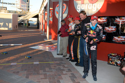 Raybestos Rookie of the Year radio-controlled car race event: Ryan Newman, Stewart-Haas Racing Chevrolet, Scott Speed, Red Bull Racing Team Toyota, and Joey Logano, Joe Gibbs Racing Toyota race their RC cars