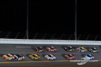 Joey Logano, Joe Gibbs Racing Toyota leads Dale Earnhardt Jr., Hendrick Motorsports Chevrolet and a group of cars