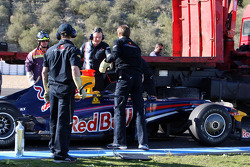 Red Bull Racing Mechanics, dechanrge the KERS from Mark Webber, Red Bull Racing, RB5,  before it can be safely returned to the pits