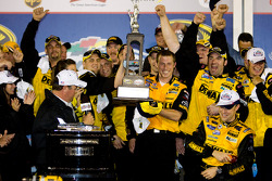 Victory lane: crew chief Drew Blickensder for Matt Kenseth hoists a trophey