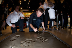 Champion's breakfast: Matt Kenseth, Roush Fenway Racing Ford, signs his Daytona 500 champion cement plate
