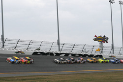 Kyle Busch, Joe Gibbs Racing Toyota, and Jeff Gordon, Hendrick Motorsports Chevrolet, lead the field out of Turn 1