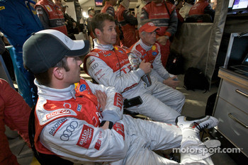Mike Rockenfeller, Tom Kristensen and Rinaldo Capello watch the end of the race