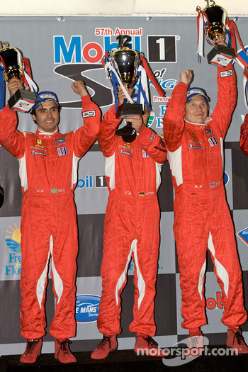 GT2 podium: class winners Jaime Melo, Mika Salo and Pierre Kaffer
