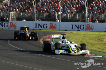 Rubens Barrichello, Brawn GP leads Sebastian Vettel, Red Bull Racing, RB5