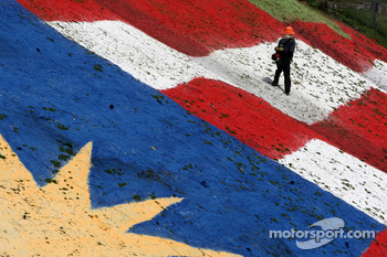 A man sprays the Malaysian flag