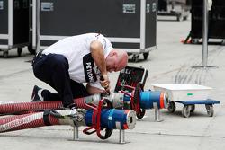 BMW mechanic with fuel hose