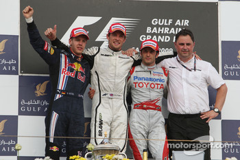 Podium: race winner Jenson Button, Brawn GP, second place Sebastian Vettel, Red Bull Racing, third place Jarno Trulli, Toyota Racing