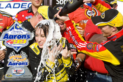 Victory lane: race winner Brad Keselowski, Phoenix Racing Chevrolet, gives a champagne shower to Miss Sprint Cup
