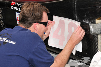 Corsa Motorsports technician applies the #48 decal