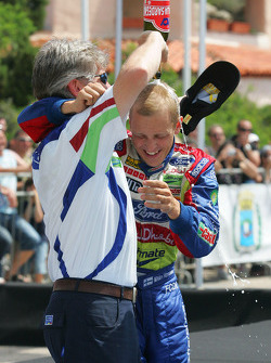 Podium: Champagne for Mikko Hirvonen
