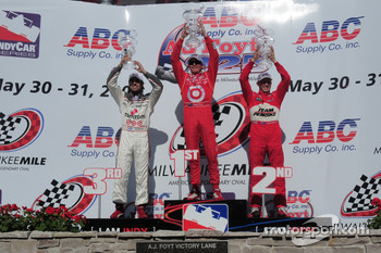 Victory lane: race winner Scott Dixon, second place Ryan Briscoe, third place Dario Franchitti