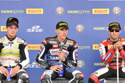 Race winner Ben Spies, second place Michel Fabrizio, third place Jonathan Rea