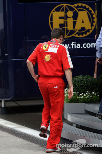 Stefano Domenicali, Scuderia Ferrari, Sporting Director goes into the Ferrari motorhome for a meeting