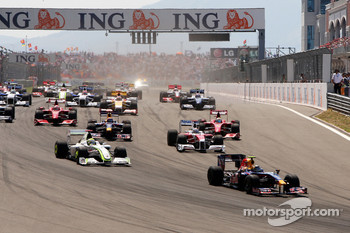 Sebastian Vettel, Red Bull Racing leads Jenson Button, Brawn GP at the start