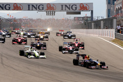 Sebastian Vettel, Red Bull Racing leads Jenson Button, Brawn GP at the start