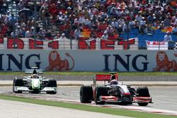 Heikki Kovalainen, McLaren Mercedes leads Rubens Barrichello, Brawn GP
