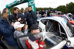 Fans look on as the #96 Virgo Motorsport Ferrari F430 GT is about to enter scrutineering
