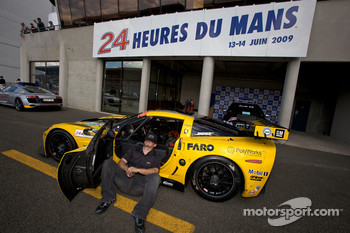 Corvette Racing team member takes a brake prior to tech inspection