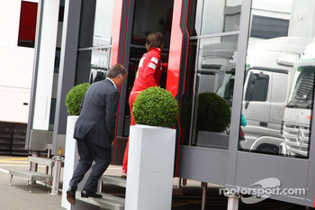 Dave Ryan walks into the Ferrari motorhome