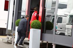 Dave Ryan walks into the Ferrari motorhome