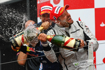 Podium: race winner Sebastian Vettel, Red Bull Racing, third place Rubens Barrichello, Brawn GP