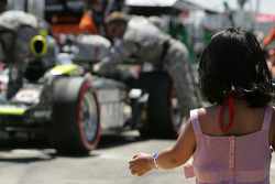 A young fan watches pit action