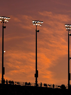 The sun sets on the grandstands