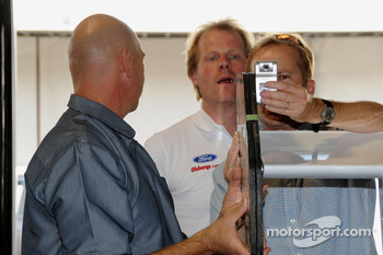Andreas Eriksson helps with the mounting of video cameras prior to practice for the Pikes Peak Hillclimb