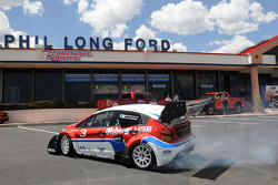 Ford Fiesta driver Marcus Gronholm arrives to a press conference in style at Phil Long Ford in Colorado Springs