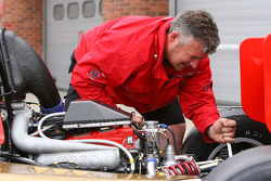 An engineer works on a Formula Two car