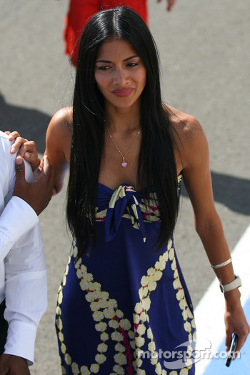 Nicole Scherzinger, Singer in the Pussycat Dolls and girlfriend of Lewis Hamilton runs to the podium
