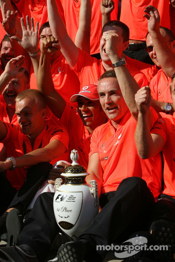 McLaren Mercedes victory celebration: race winner Lewis Hamilton celebrates with Heikki Kovalainen, Martin Whitmarsh and McLaren Mercedes team members
