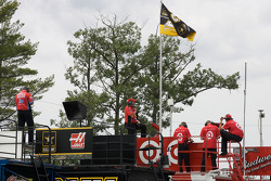 Crew members watch practice from atop their haulers