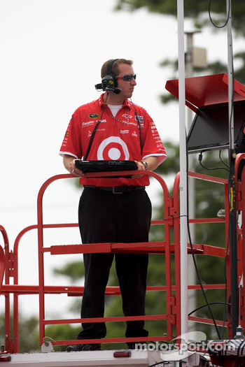 Earnhardt Ganassi Racing Chevrolet crew member watches practice from atop his hauler