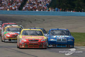 Marcos Ambrose, JTG Daugherty Racing Toyota and Kurt Busch, Penske Racing Dodge battle for the lead