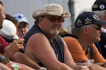 Fans wait for the race restart