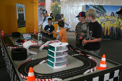 Kids racing on a carrera race track in the fan zone boulevard, part of the new Ring Werk